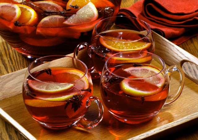 Mulled wine in punch bowl and glass cups